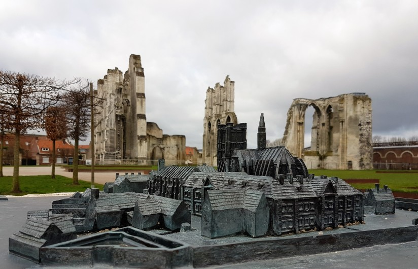 Bronze model of the Abbey and ruins in the background
