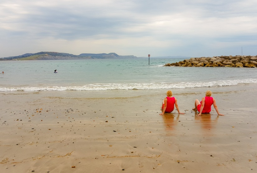 Twins relaxing on the beach UK coast_edited